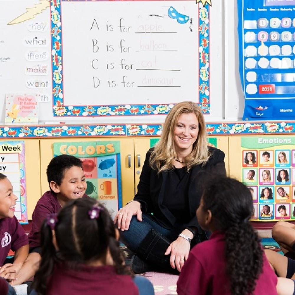Carrie Walton Penner visits with a kindergarten class