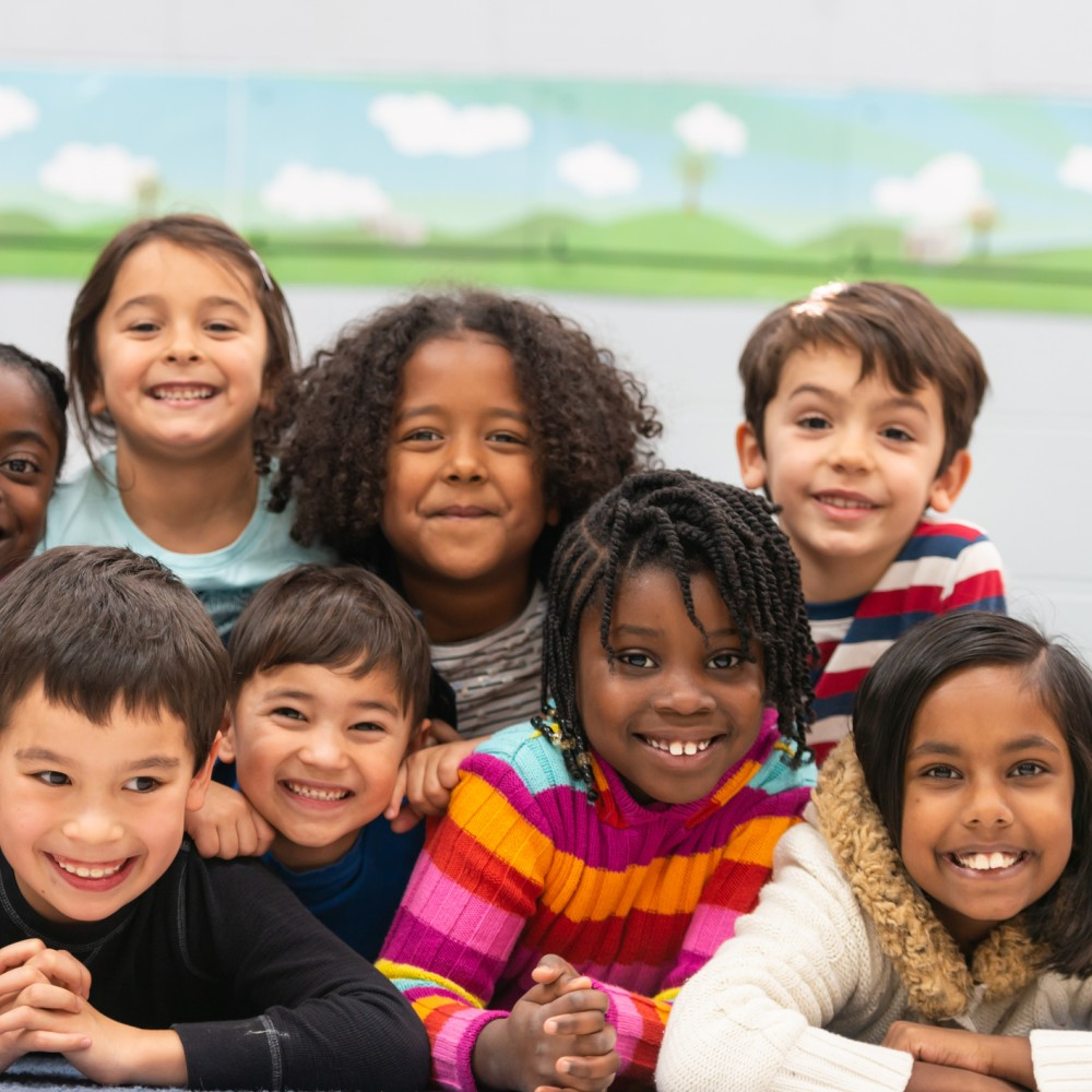 Diverse elementary students smiling
