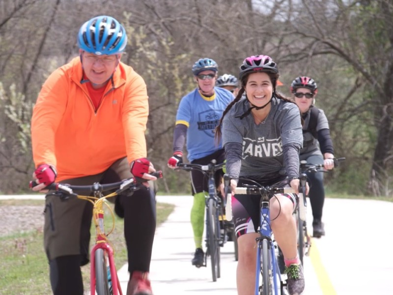 Group of bikes people cycling on trails in Northwest Arkansas